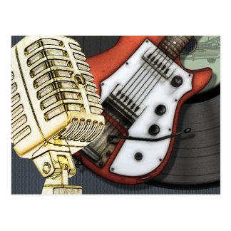 Guitarra del vintage y postal del micrófono