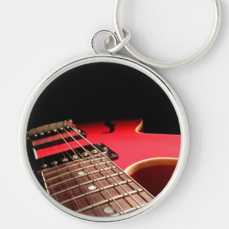 Guitarra eléctrica roja llavero redondo plateado