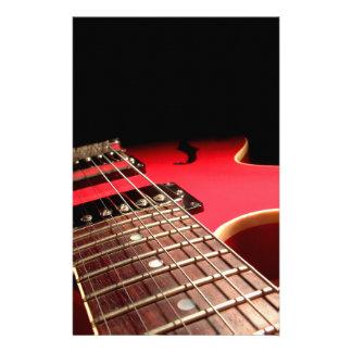 Guitarra eléctrica roja  papeleria de diseño