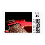 Guitarra eléctrica roja sellos