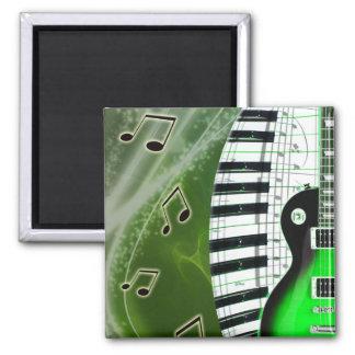 Guitarra eléctrica verde con el teclado iman para frigorífico