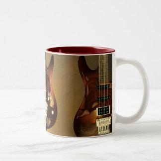 Guitarra ideal - tazas de café de la tolerancia