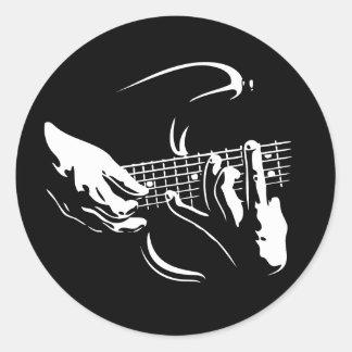 guitarra-manos-DKT Etiqueta Redonda