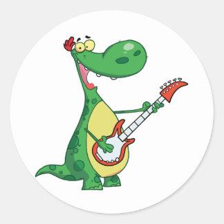 Guitarra que juega a los pegatinas del dinosaurio pegatina redonda