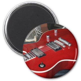 Guitarra roja en el amperio imán redondo 5 cm