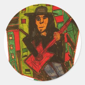 guitarra roja etiqueta redonda