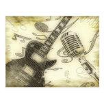 Guitarra y micrófono del vintage postal