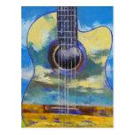 Guitarra y postal de las nubes