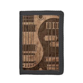 Guitarra y Yin bajo Yang con el efecto de madera d