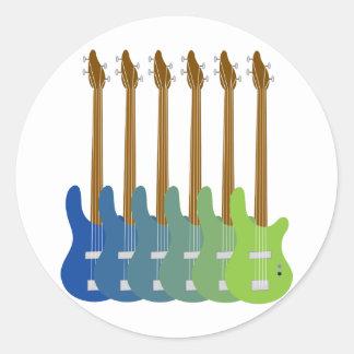 Guitarras bajas coloridas etiqueta redonda