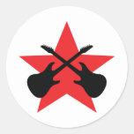 Guitarras cruzadas estrella roja etiquetas redondas