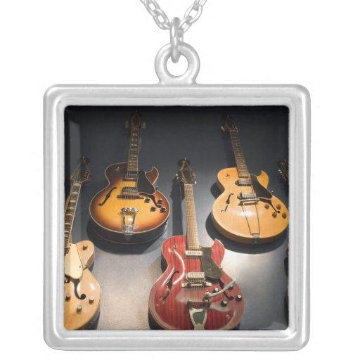 Guitarras del vintage colgante cuadrado