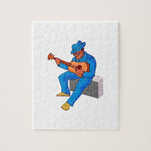 guitarrista que se sienta en los azules blue.png d rompecabeza