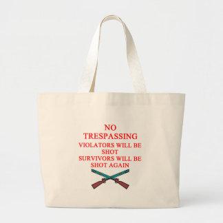 gun owner no trespassing tote bag