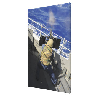 Gunners Mate firing a 50 caliber machine gun Canvas Print