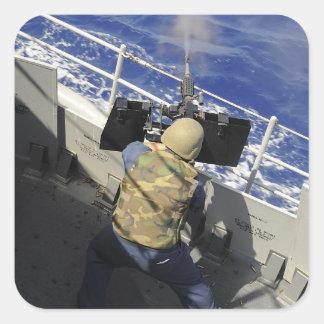 Gunners Mate firing a 50 caliber machine gun Square Stickers