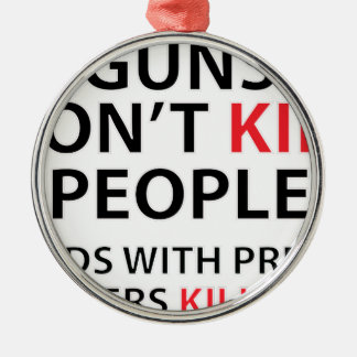 Guns don't kill people. Dads with pretty daughters Round Metal Christmas Ornament