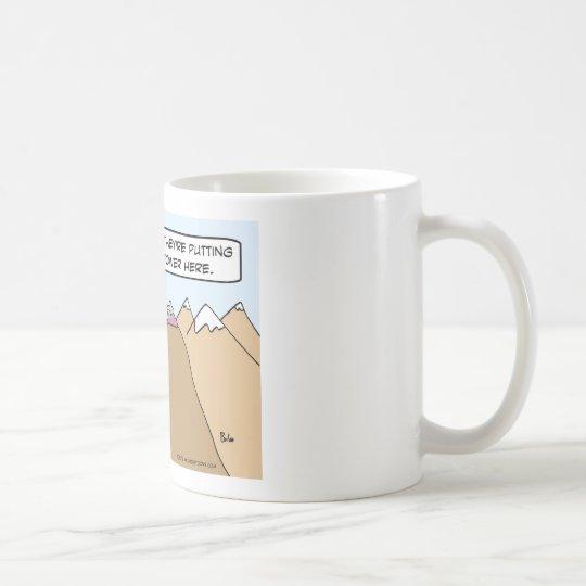 Guru has to move for cell phone tower. coffee mug