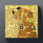 "Gustav Klimt Fulfillment Plaque<br><div class=""desc"">Gustav Klimt Fulfillment plaque. Frieze from 1909. Completed during Klimt's golden phase, Fulfillment features an embracing couple holding each other beneath a multi-patterned quilt featuring spirals, eyes, birds, fish and other shapes. The background of the work features the same bronze spirals that would adorn the artist's renowned Tree of Life....</div>"