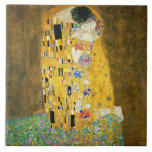"""Gustav Klimt The Kiss Vintage Art Nouveau Painting Ceramic Tile<br><div class=""""desc"""">Gustav Klimt The Kiss Vintage Art Nouveau Painting The Kiss (In German: Der Kuss) was painted by the Austrian Symbolist painter Gustav Klimt between 1907 and 1908, the highpoint of his Golden Period, when he painted a number of works in a similar gilded style. The painting is widely considered a...</div>"""