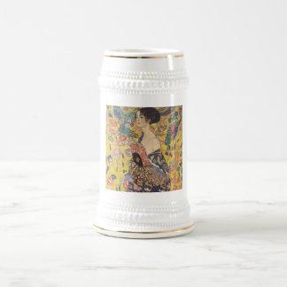 Gustavo Klimt - mujer con la fan Tazas