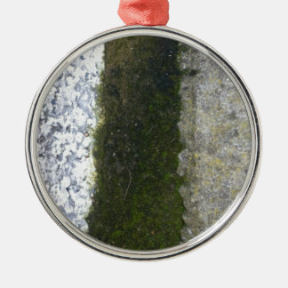 Gutter Trash -- Slime with concrete gutter. Round Metal Christmas Ornament