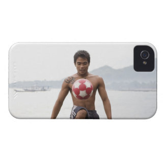 Guy playing football on beach iPhone 4 case