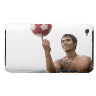Guy spinning football on finger iPod touch case