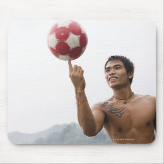 Guy spinning football on finger mouse pad