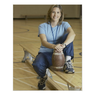 Gym teacher sitting on bench in gym poster