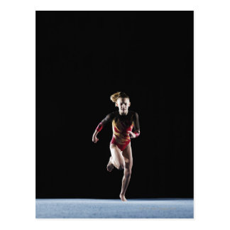 Gymnast (12-13) running on mat postcard