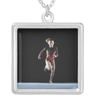 Gymnast (12-13) running on mat silver plated necklace