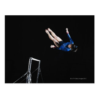 Gymnast (16-17) dismounting uneven bars postcards