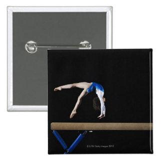 Gymnast (9-10) flipping on balance beam, side button