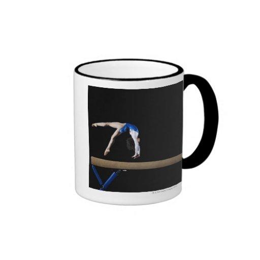 Gymnast (9-10) flipping on balance beam, side ringer coffee mug