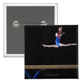 Gymnast (9-10) leaping on balance beam 2 2 inch square button