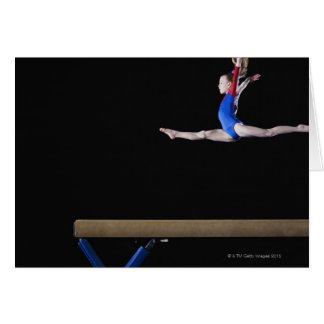 Gymnast (9-10) leaping on balance beam 2 card