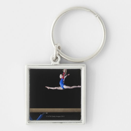 Gymnast (9-10) leaping on balance beam 2 keychain