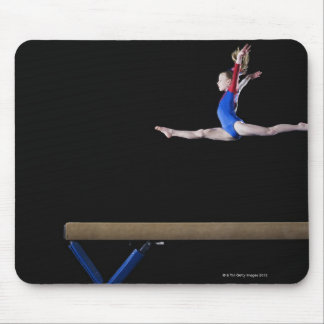 Gymnast (9-10) leaping on balance beam 2 mouse pad
