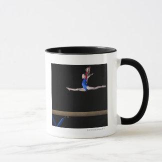 Gymnast (9-10) leaping on balance beam 2 mug