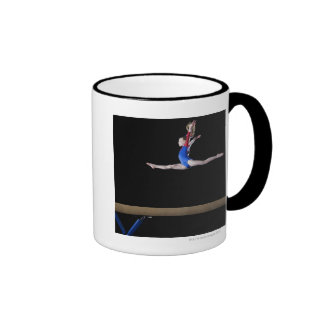 Gymnast (9-10) leaping on balance beam 2 coffee mug