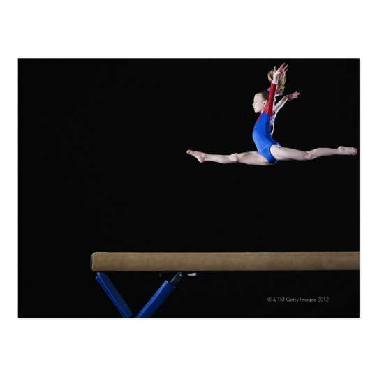 Gymnast (9-10) leaping on balance beam 2 postcard