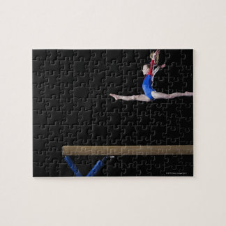 Gymnast (9-10) leaping on balance beam 2 jigsaw puzzle