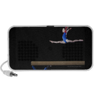 Gymnast (9-10) leaping on balance beam 2 PC speakers