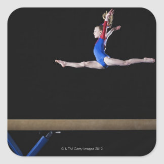 Gymnast (9-10) leaping on balance beam 2 square sticker