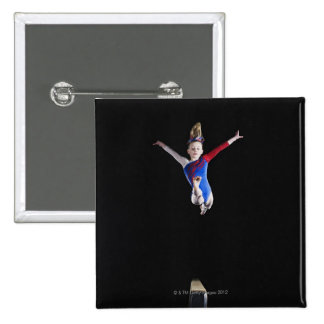 Gymnast (9-10) leaping on balance beam 2 inch square button