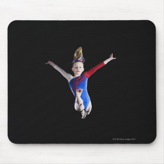 Gymnast (9-10) leaping on balance beam mouse pad