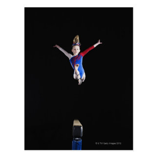 Gymnast (9-10) leaping on balance beam post cards