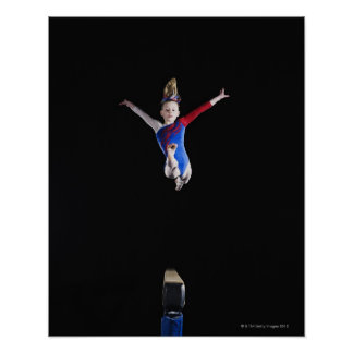 Gymnast (9-10) leaping on balance beam poster