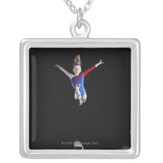 Gymnast (9-10) leaping on balance beam silver plated necklace